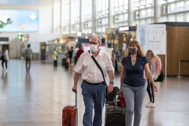 People with face masks at Brussels Airport.