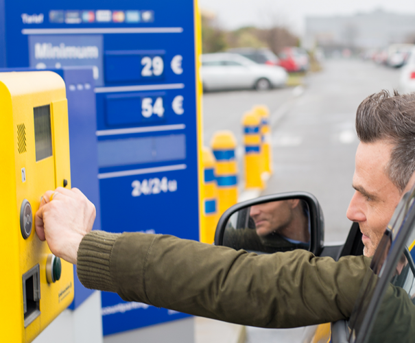 Man pays for parking at Brussels Airport.